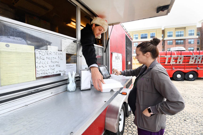 Despite Rainy Debut Food Truck Park Brings New Dining Options To