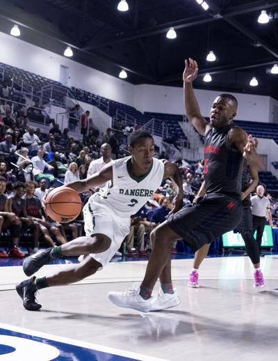 Rudder boys basketball team loses to Manvel in regional semifinals