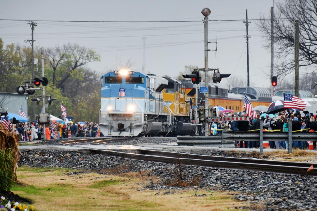 Spectators Line Navasota Streets As Bush Funeral Train Passes