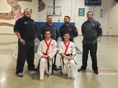 Area students earn first-degree black belts