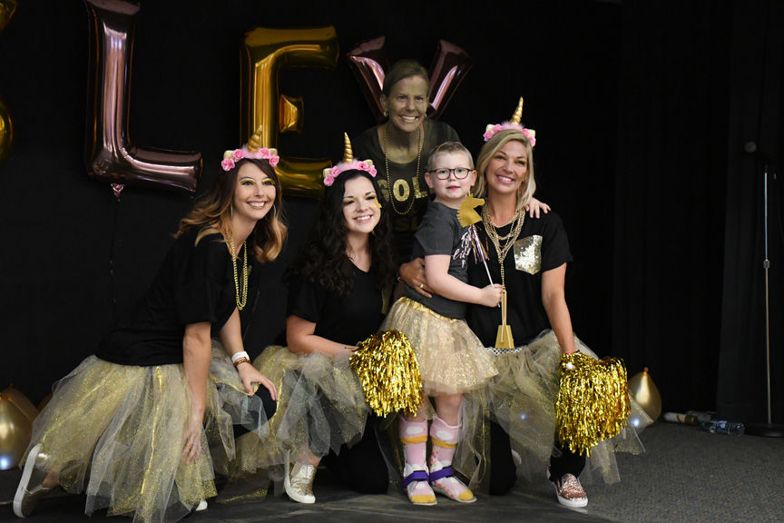 Bryan school goes gold for first grader battling leukemia