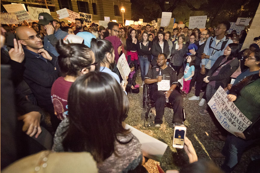 Texas A&M crowd protests travel ban