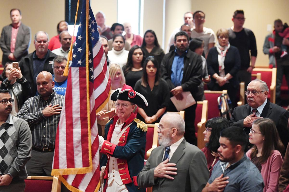 Brazos County welcomes 99 new American citizens from around the