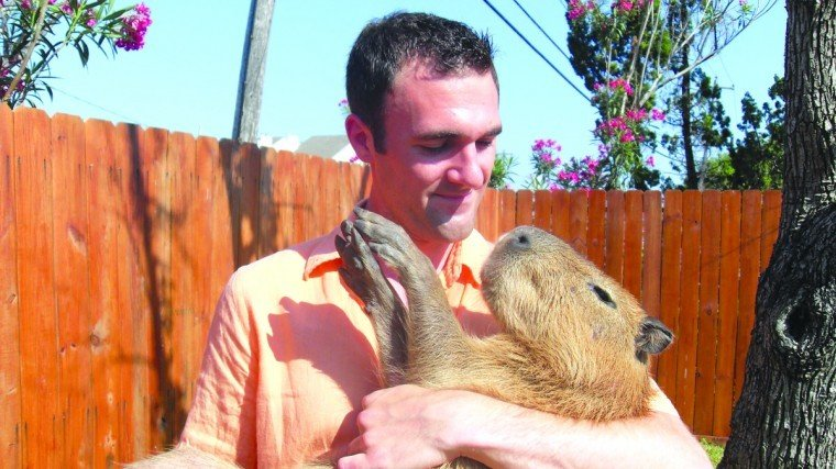 Taylor with capybara