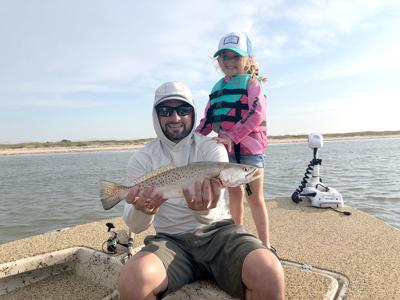 Father-daughter fishing success