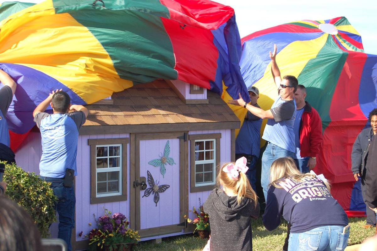Ascend Cares, BACH unite to give playhouses to disabled
