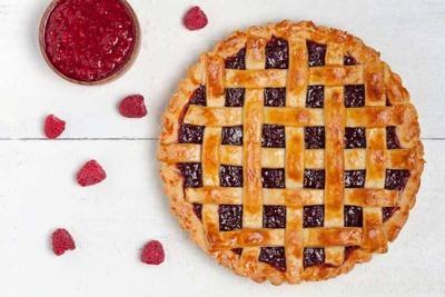 Raspberry pie with fresh raspberries and raspberry jam on white table
