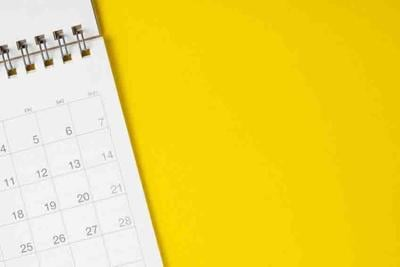 White clean calendar on solid yellow background with copy space, business, travel or project planning concept