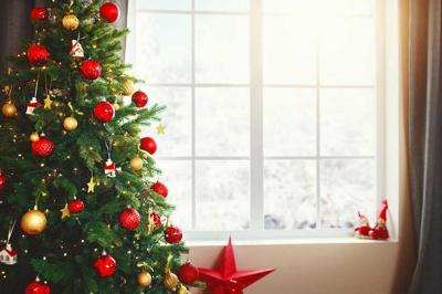 Christmas interior tree with gifts near window at home