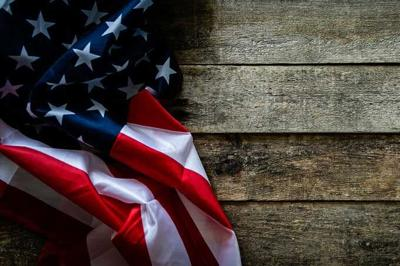 4th of July concept - wood backgrouns with american flag