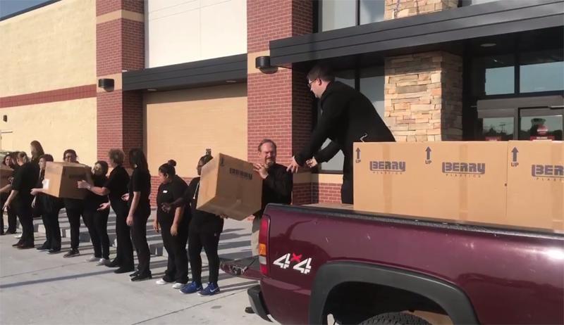 Burlington employees load donations for Hope Harbor