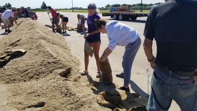Volunteers fill sandbags in Wood River