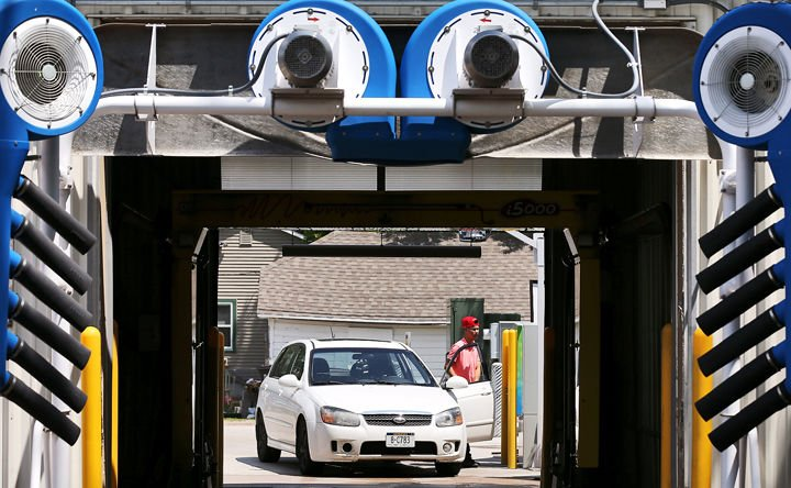 Family owned gosdas car wash celebrating a half century of business erick loyola of grand island prepares to use the hands free auto wash at gosdas car wash on south locust street in grand island solutioingenieria Image collections