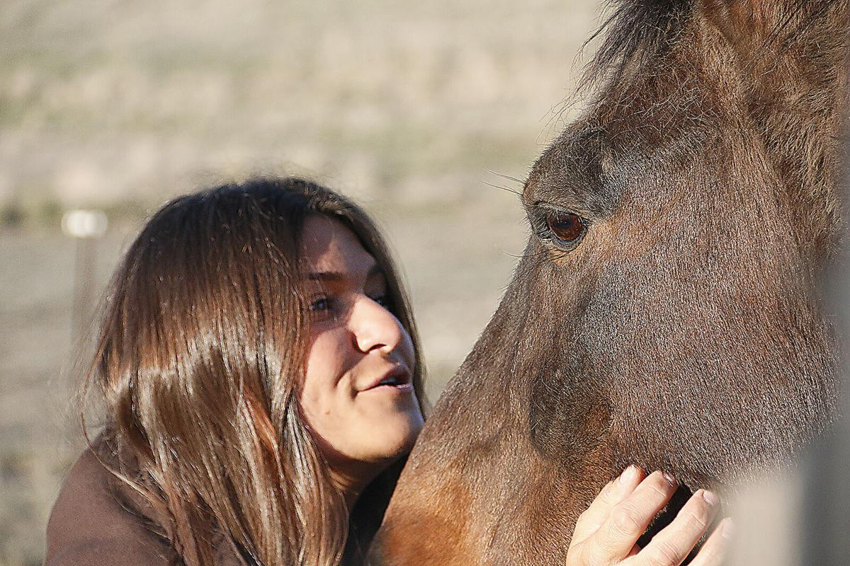 WATCH NOW: Together again, woman reunites with beloved horse