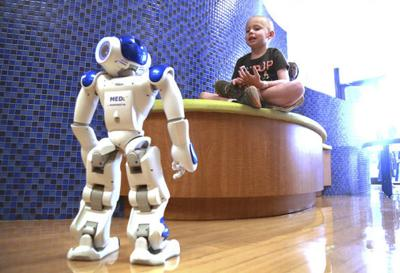 Interactive robot befriends hospital's youngest patients to soothe away their anxiety