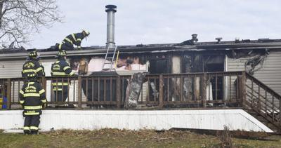 People uninjured, but dog missing after trailer fire