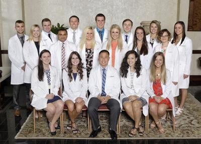 LP man among students in white coat ceremony