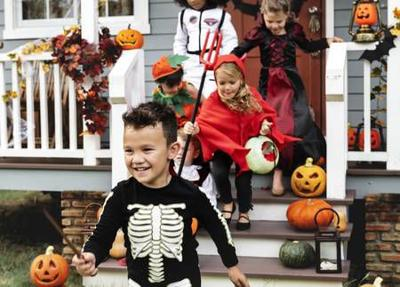 108610563-young-kids-trick-or-treating-during-halloween.jpg