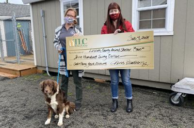 Linda Ireland-Deb Dixon-and Cooper at Lincoln County Animal Shelter(1).jpg