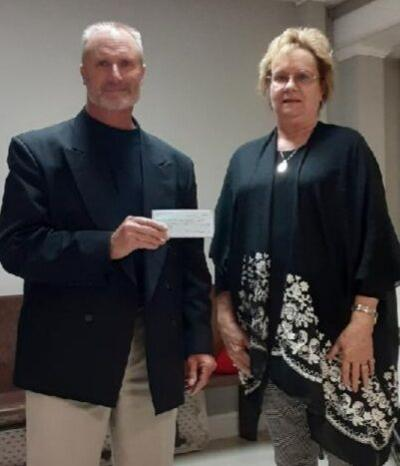 The Clarksville Lions Club donate to Hunters for the Hungry