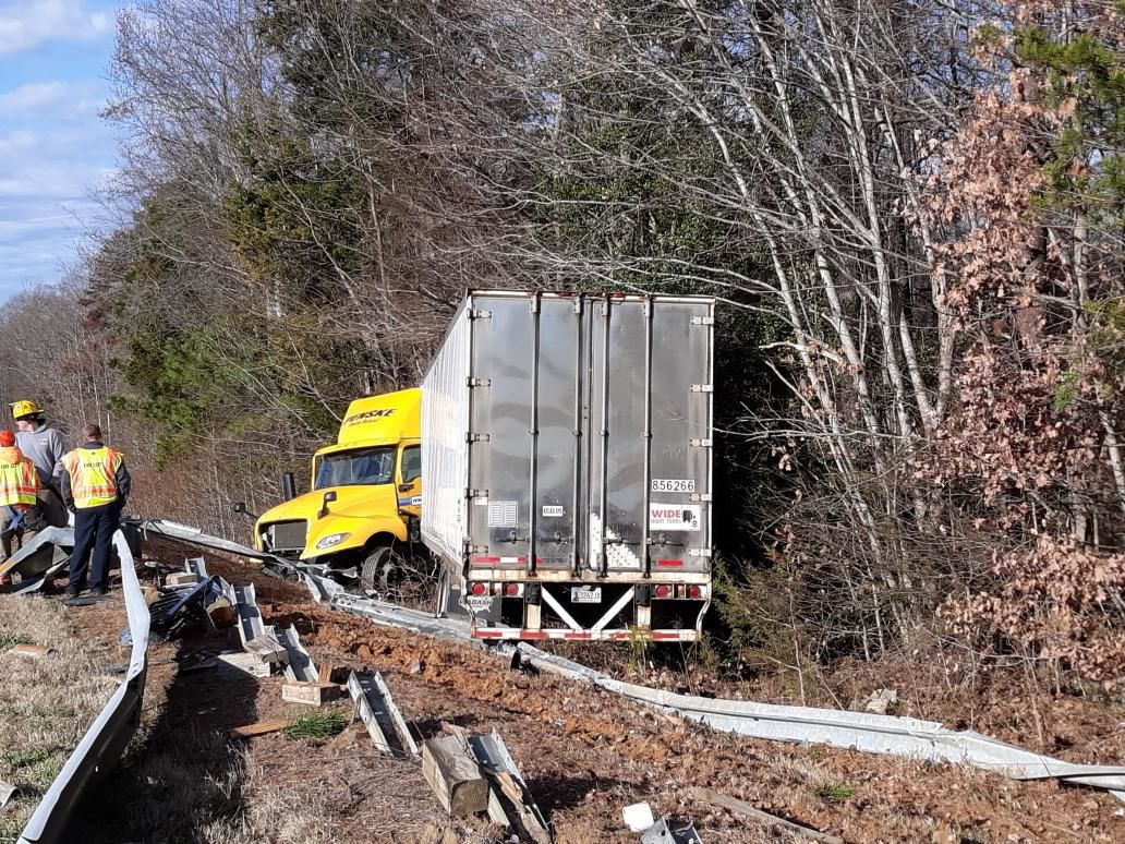 Tractor trailer runs off road, causing damage to guard rail
