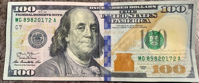 Holly fake or counterfeit bill.jpg
