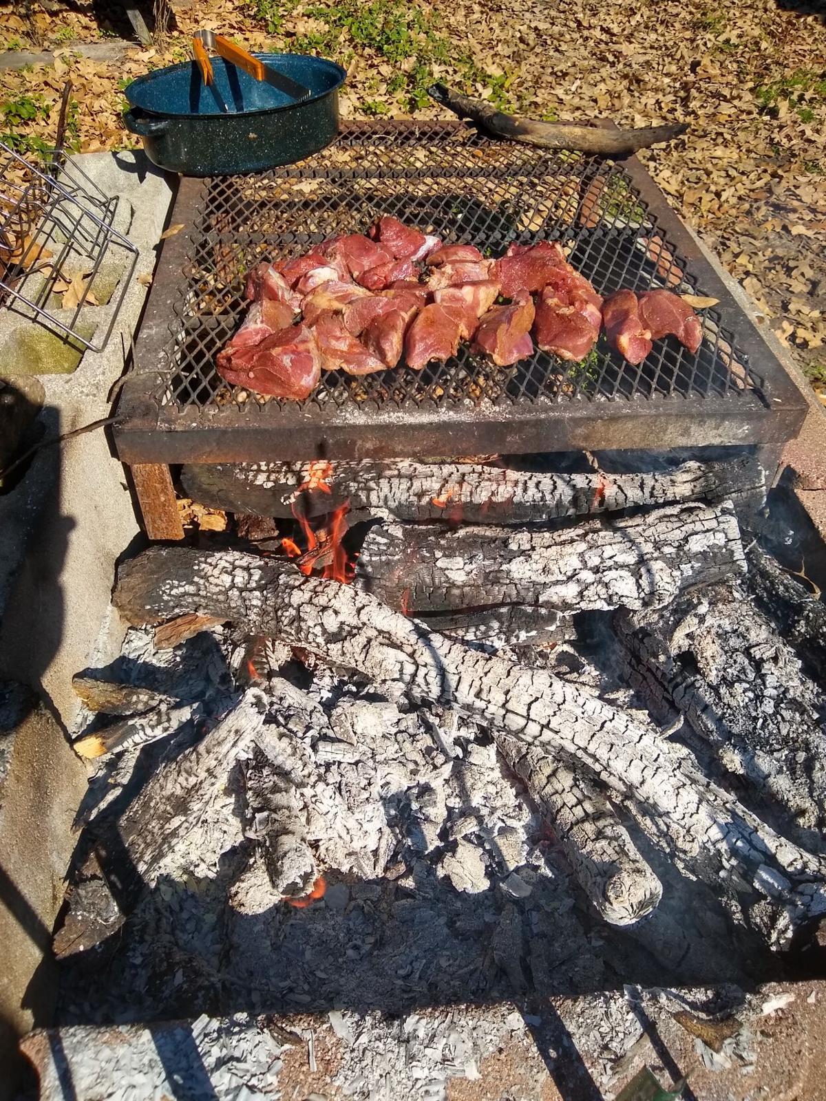 WILD PORK COOKING OVER COALS.jpg