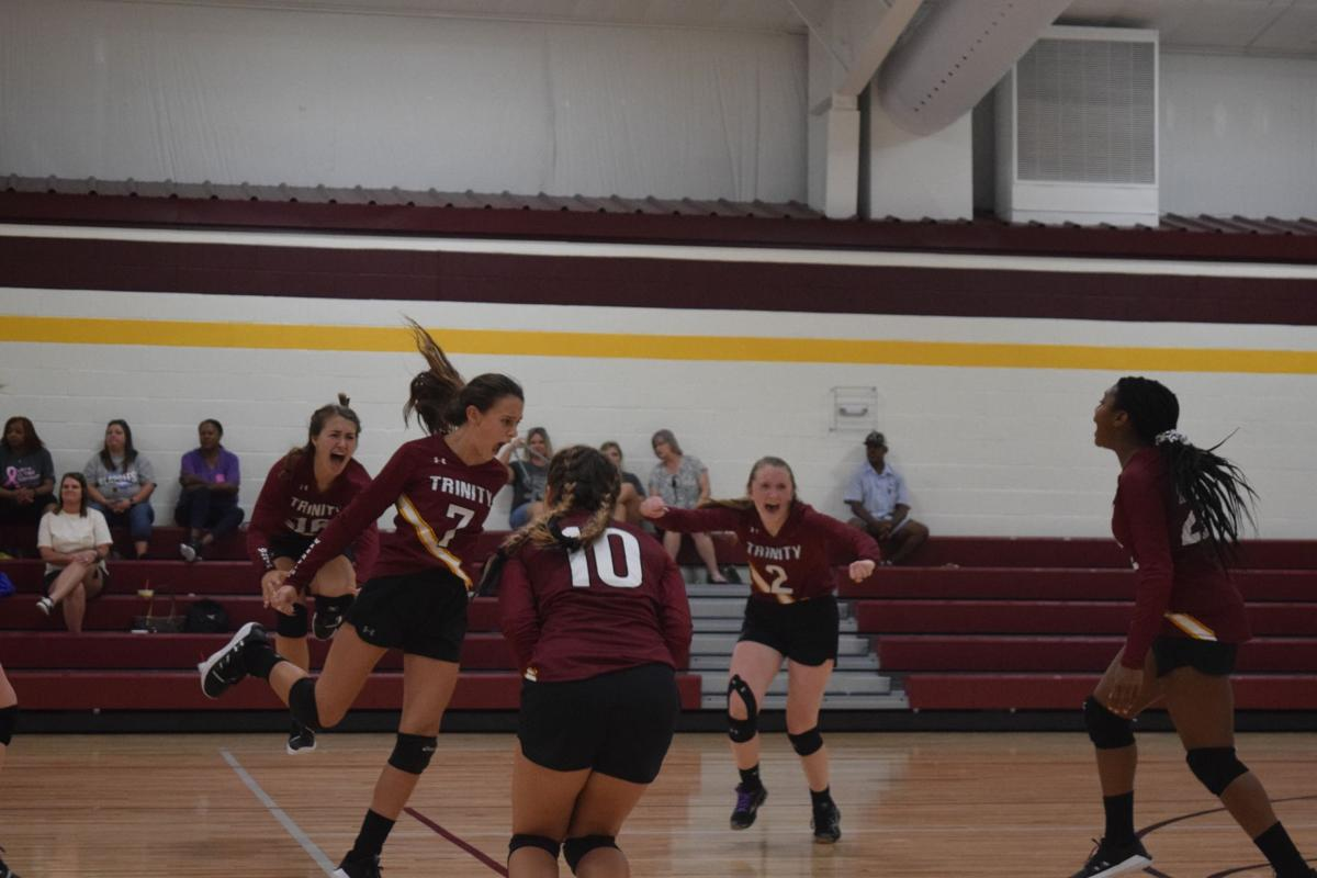 Trinity Christian celebrates volleyball victory