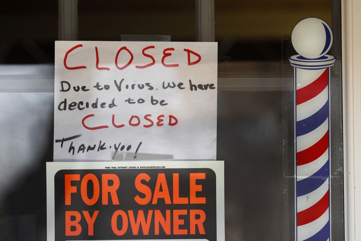 APTOPIX Virus Outbreak Michigan Economy