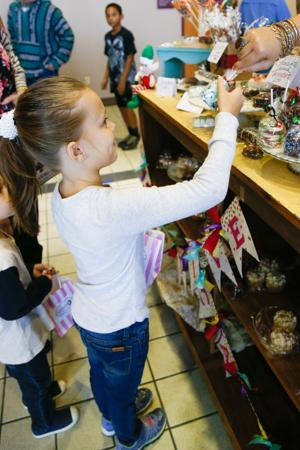 """<p class=""""p1""""><span class=""""s1""""><strong>Annabelle Smith</strong></span> <span class=""""s2"""">receives a chocolate-covered marshmallow at Christmas in Paris on Saturday at Love Civic Center.</span></p>"""