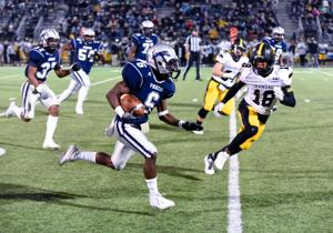 "<p class=""p1"">Paris wide receiver <span class=""s1""><strong>Montavious McCarty (6)</strong></span> breaks a tackle, then races down the field for more yards after the catch during the second quarter of Paris' Bi-district game against Crandall.</p>"