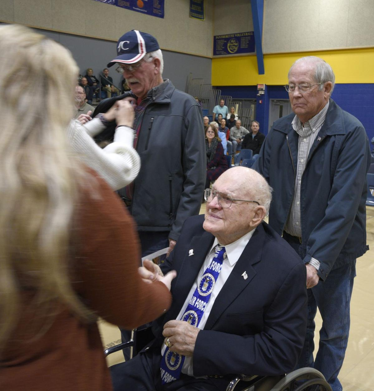 Frank McHam helps Norman Davis in pinning ceremony.jpg