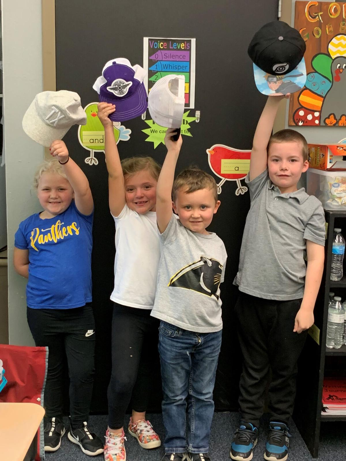 Valorie Wood's students hats up.jpg