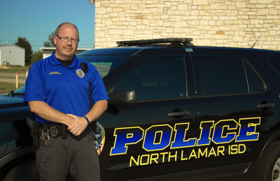 NLPD Chief Mike Boaz and his vehicle