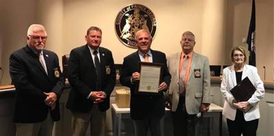 Vaccination volunteers and members of  Industrial Development Authority honored