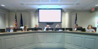 School board votes to update compensation plan, approves cheerleader field trip