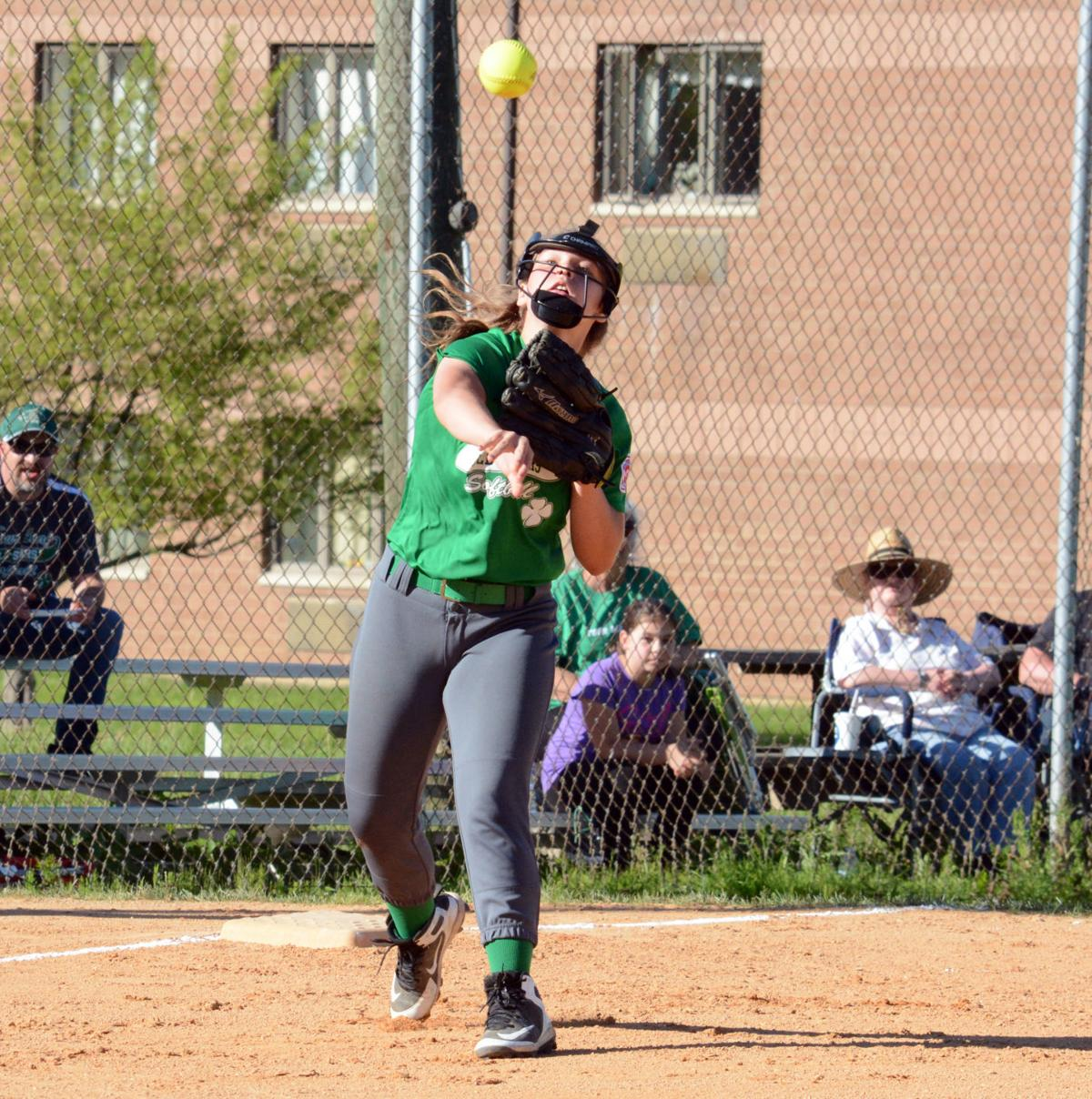 Brooke Bainey throws to first