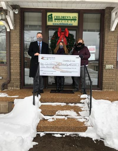 Riverview Bank donates to Children's Aid Society