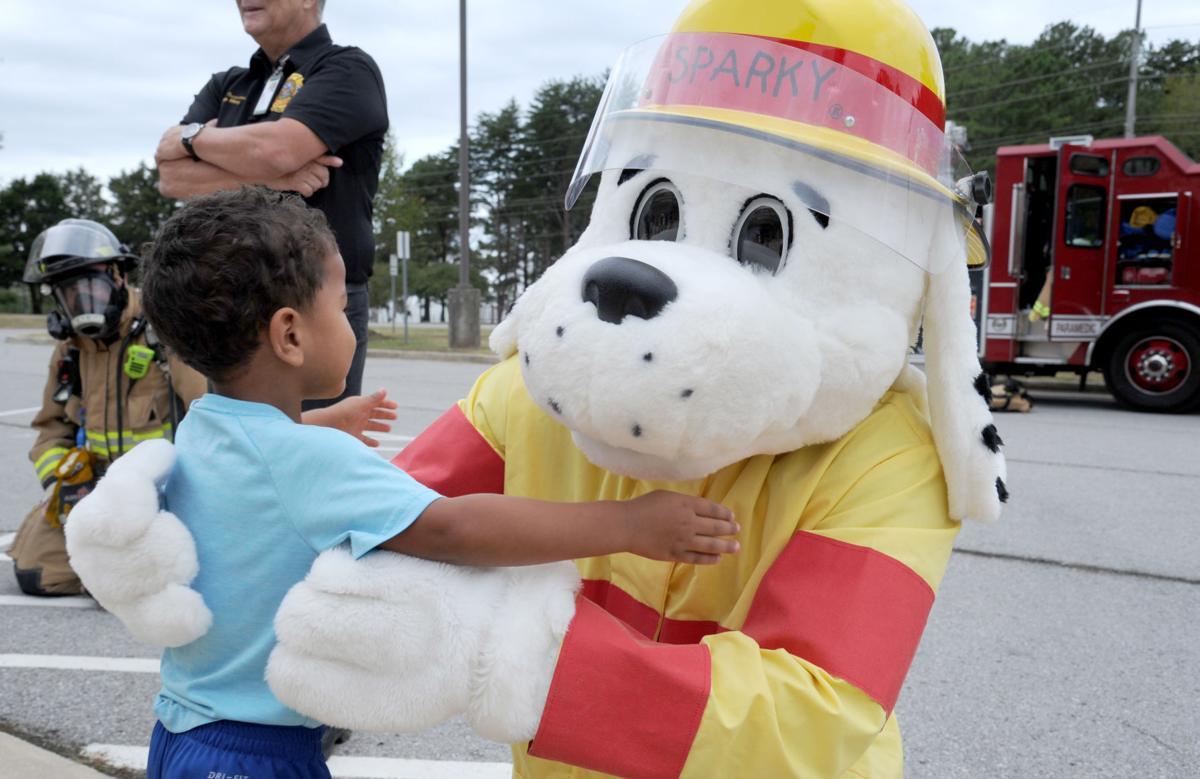 Sparky visits 1 boy hug.JPG