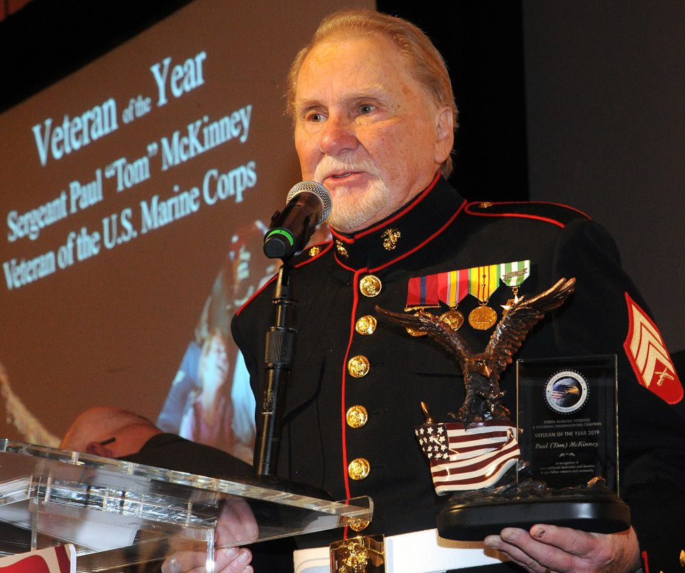 Veteran of year 1 at podium.jpg