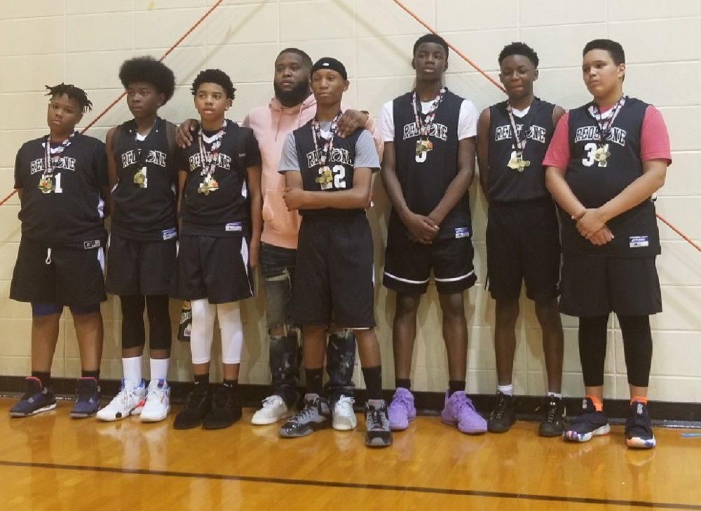Youth basketball recap 1 champs in black.jpg