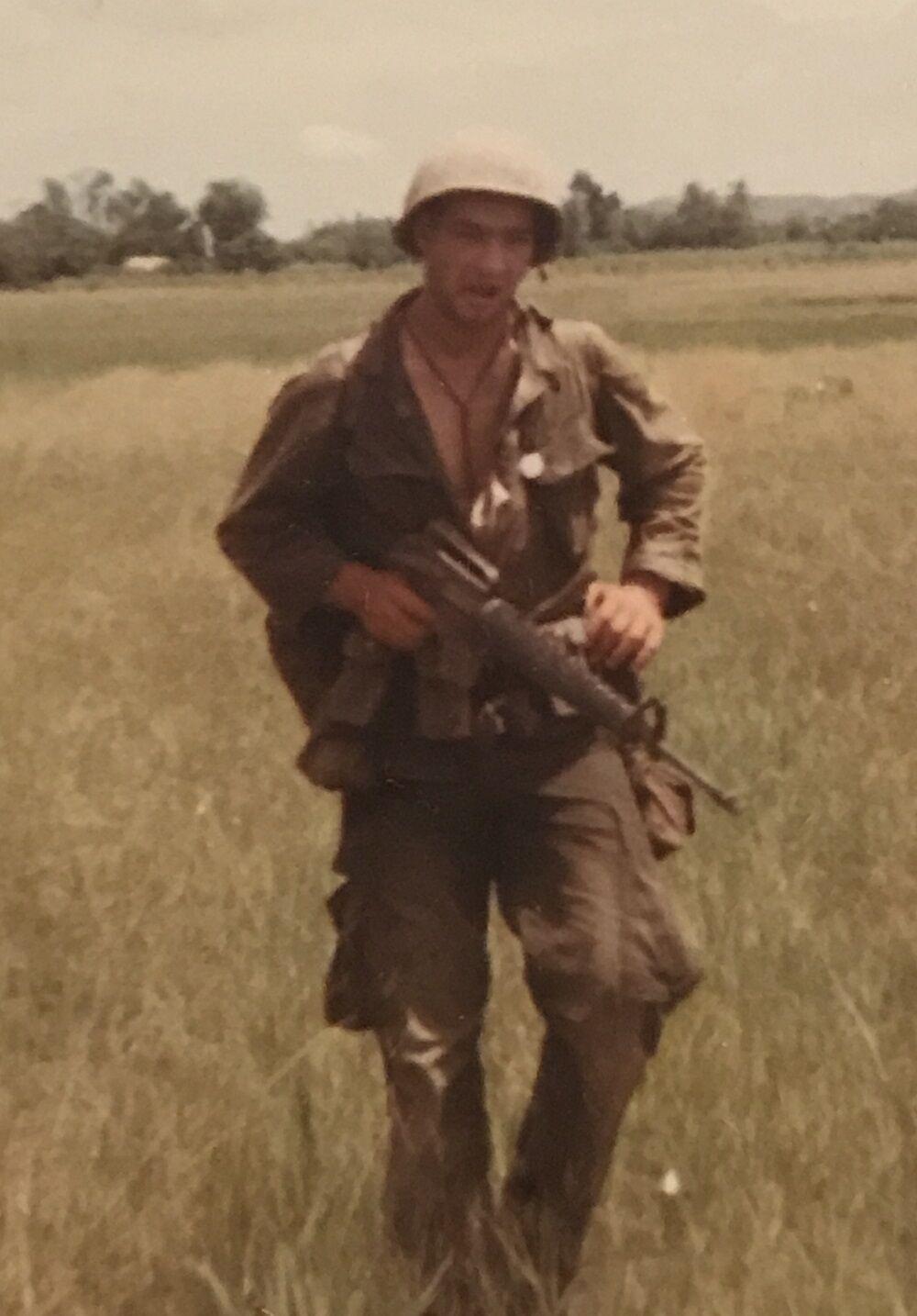 Vietnam vet Joe Bongiovanni 2 in field.jpg