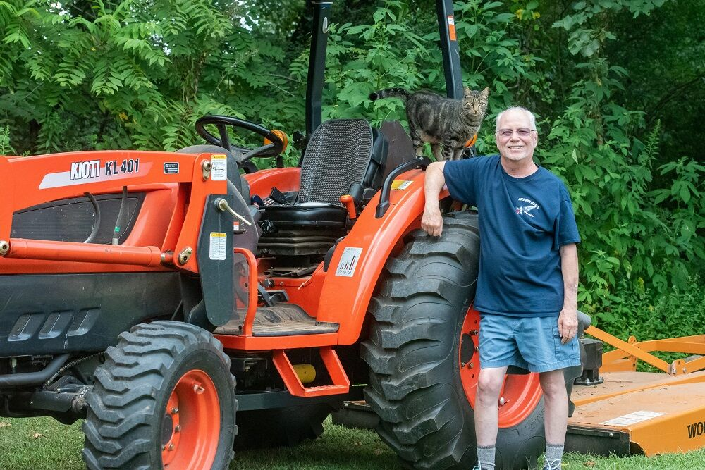 Vietnam Ray Patrick 2 with tractor today.jpg