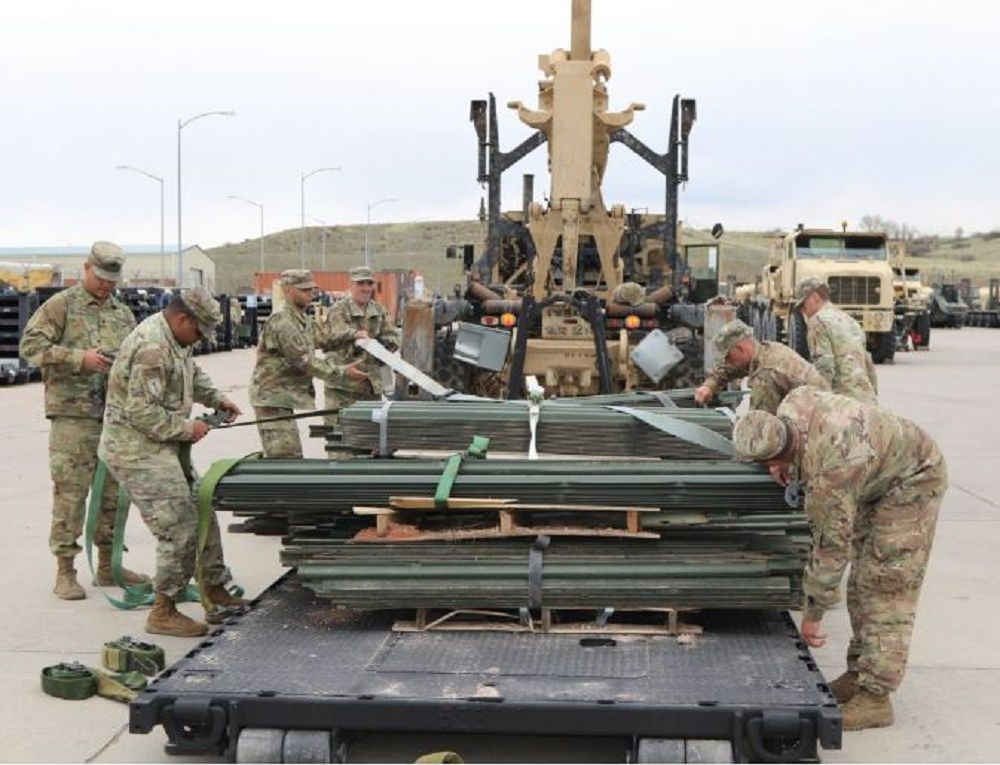 Readiness 1 Soldiers unload.jpg