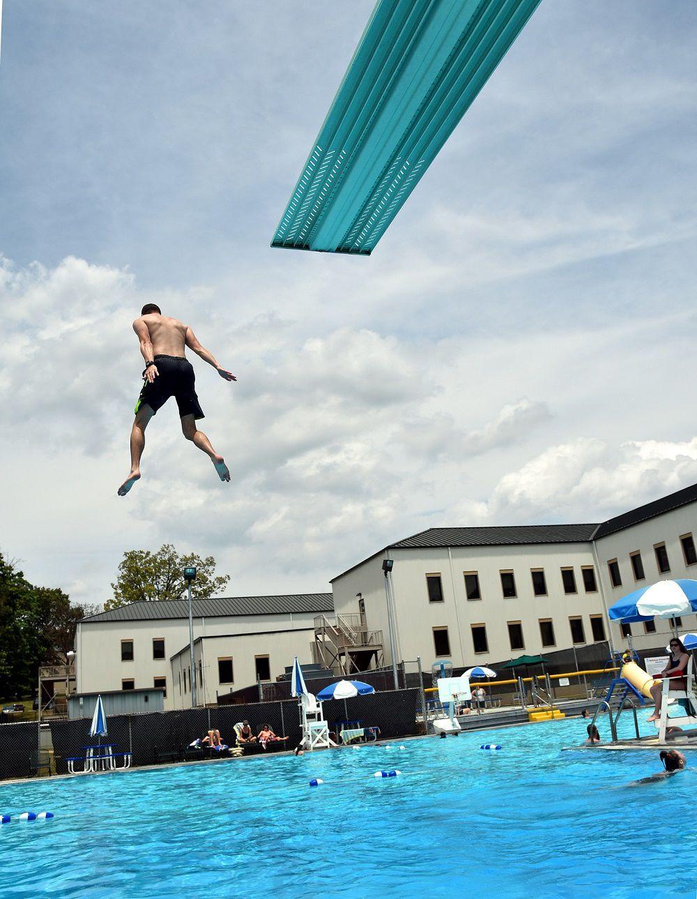 Swimming pool 1 boy dives.jpg