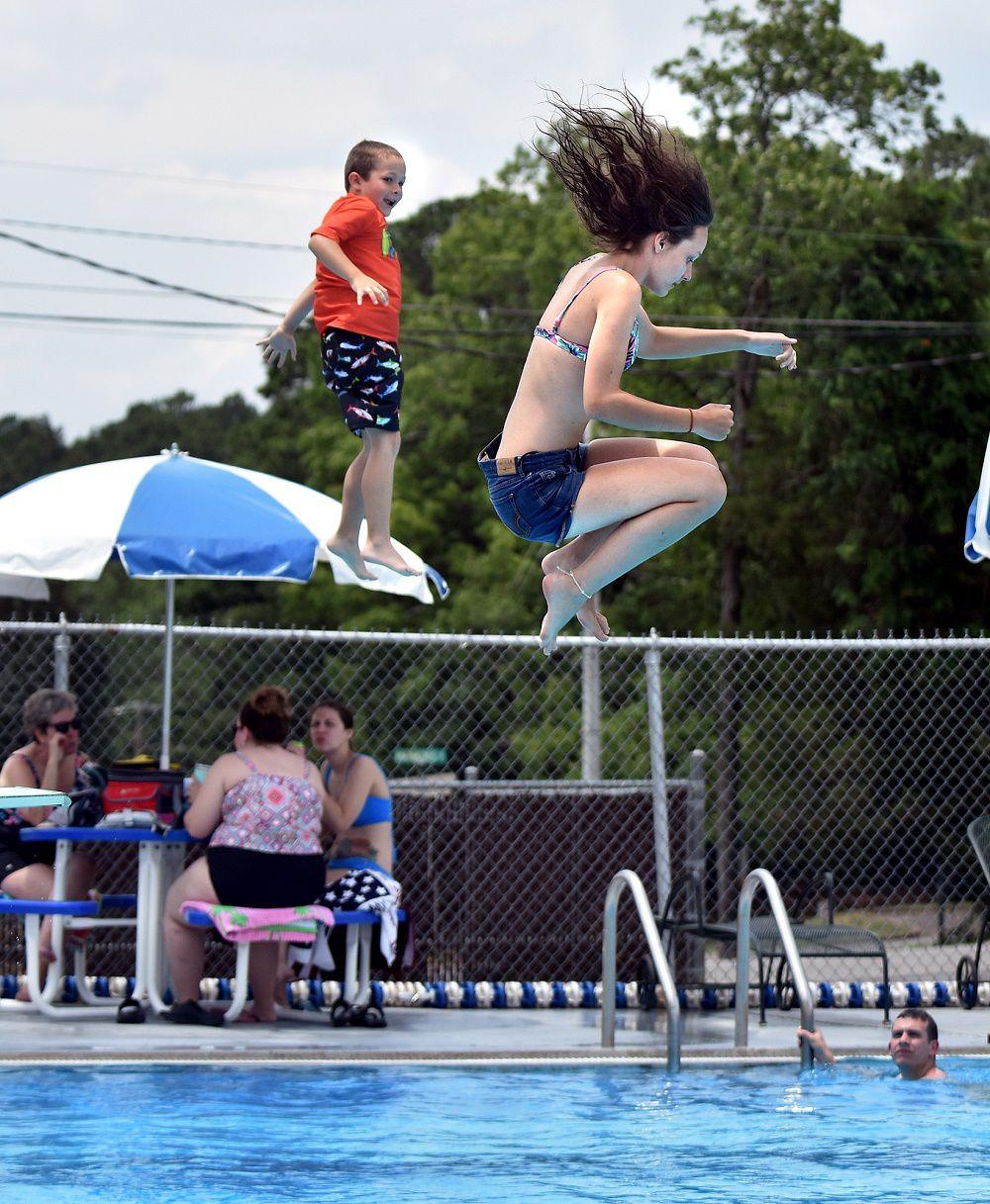 Swimming pool 2 pair jumps in.jpg