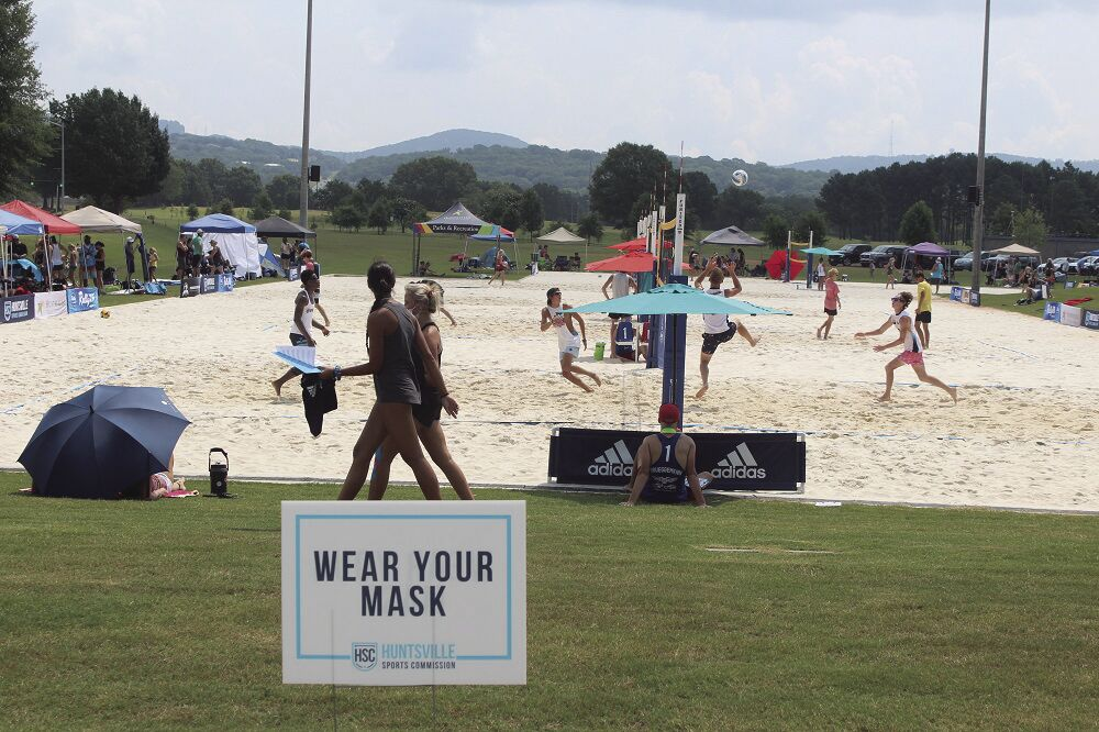 Volleyball 1 warmups with sign.jpg