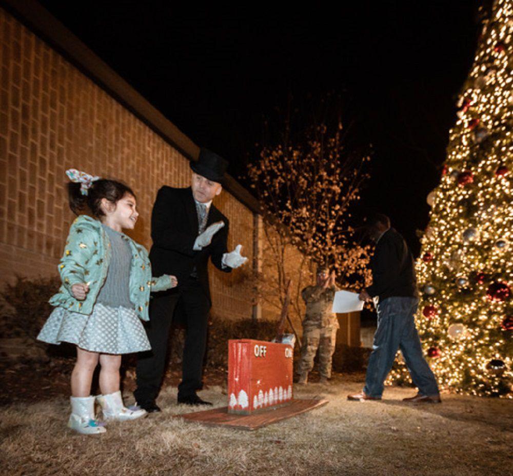 Gold Star family 1 girl lights tree.jpg