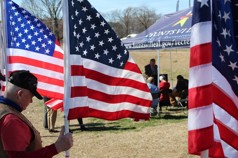Vietnam veteran John Cooper 2 flags.jpg