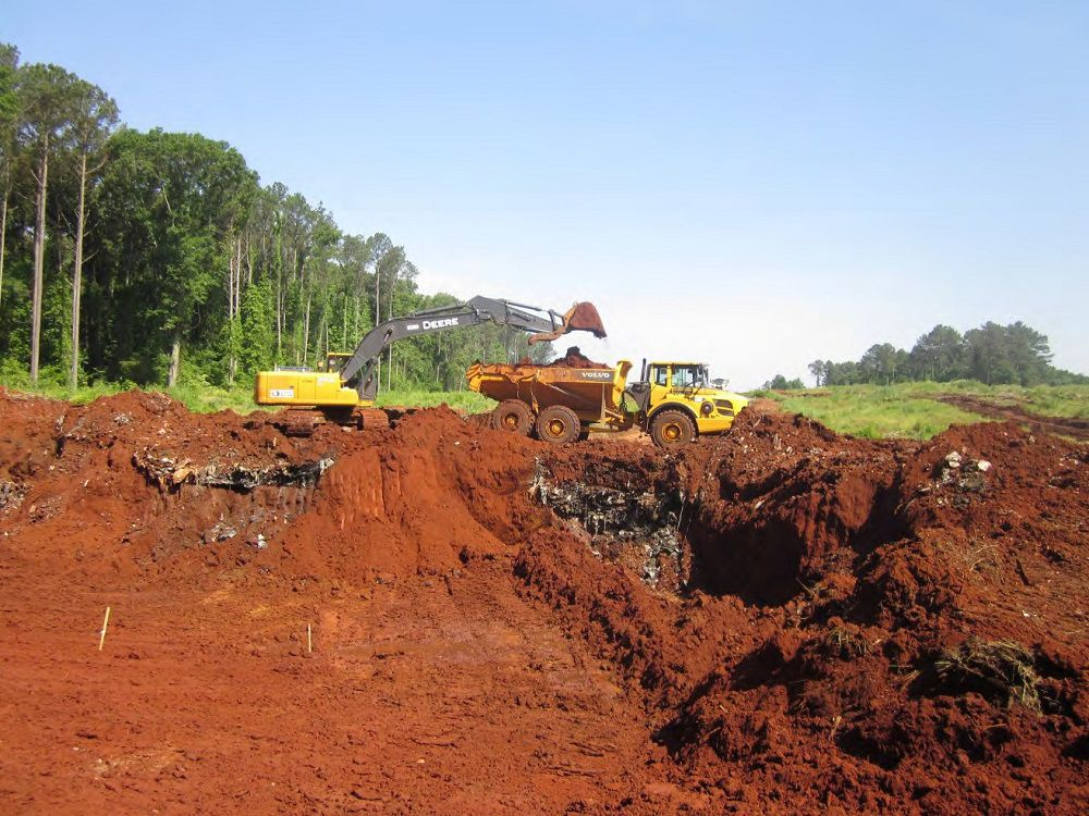 Environmental 1 bulldozer digs.jpg